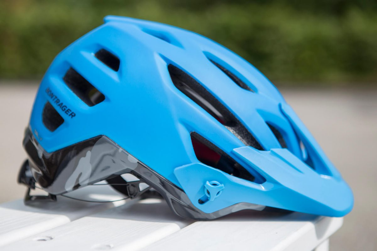 A mountain bike helmet is less aerodynamic but offers more protection.