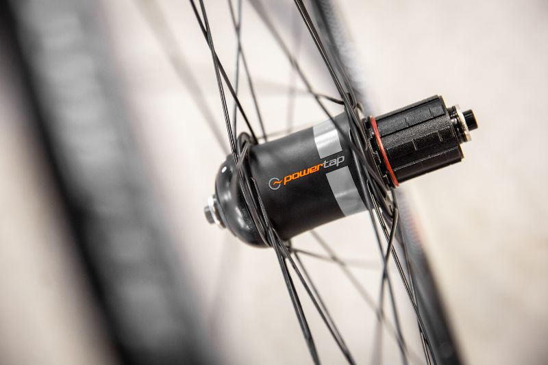 A wheel with a power meter is easy to dismount and mount onto a different bike.